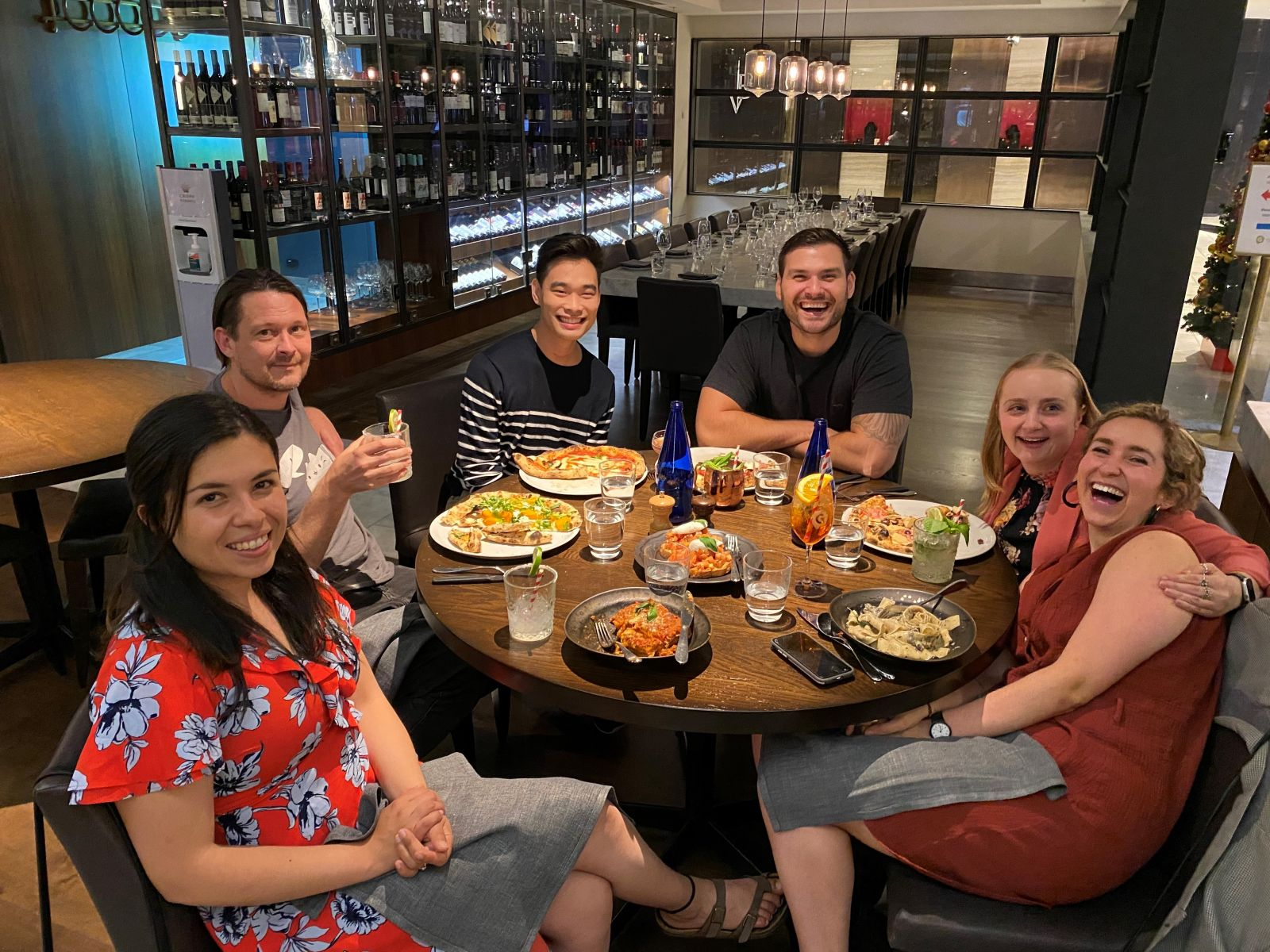 Cassandra Embling (2nd from right) and Mladen Jovanovic (3rd from right) at an end-of-year dinner with BindiMaps' team members (Source: BindiMaps)