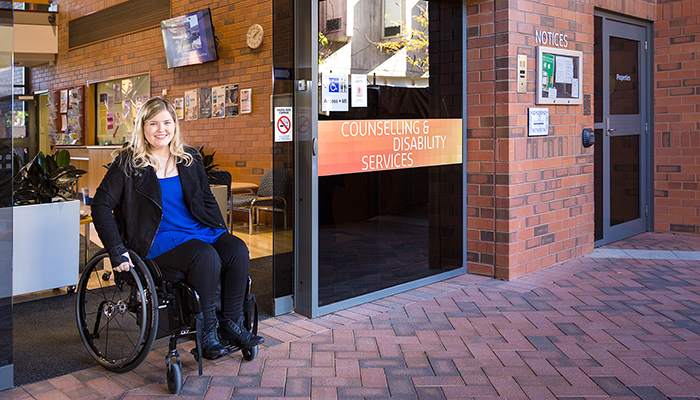 A woman in a wheelchair at Curtin University's Bentley campus in Perth (Source: Curtin University